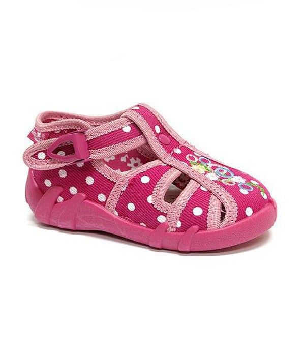 Pink shoes with white polka dots for a toddler girl