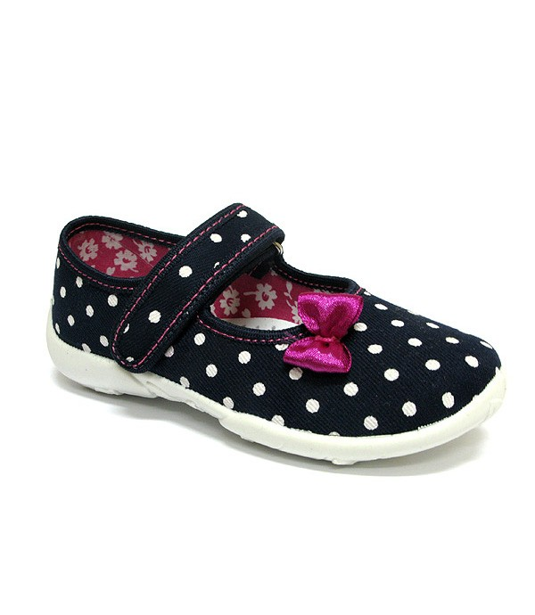 Supportive shoes for a preschool girl with white polka dots